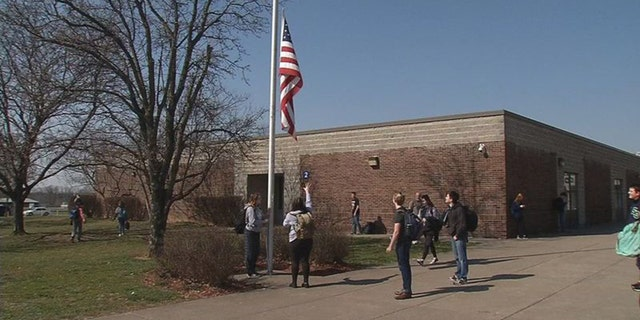 The three high school juniors who tend to the flag daily at South Oldham High School in Crestwood, Kentucky all come from military families. (WDRB Media)