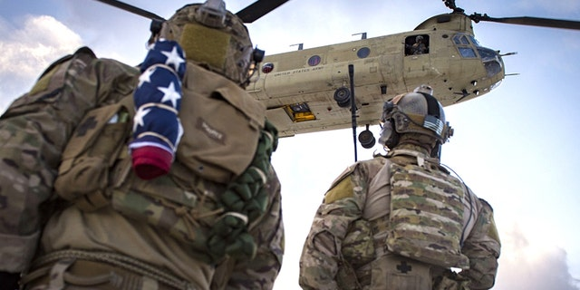 U.S. Air Force pararescuemen, assigned to the 83rd Expeditionary Rescue Squadron, prepare to board a U.S. Army CH-47F Chinook during a training mission in Afghanistan, March 15, 2018.