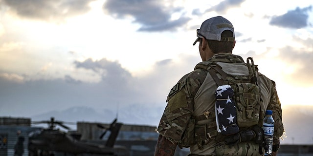 A U.S. Air Force pararescueman, assigned to the 83rd Expeditionary Rescue Squadron, surveys the flightline at Bagram Airfield, Afghanistan, March 22, 2018.