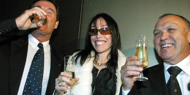 FILE 2003: Hollywood Madam Heidi Fleiss poses at the Australian Stock Exchange in Melbourne.