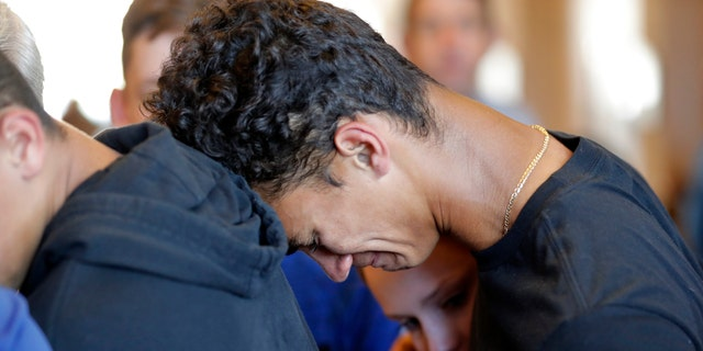 Stoneman Douglas High School students mourn the death of their classmates after a gunman opened fire and killed 17 people.