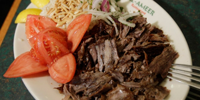 A lamb shawarma dish is shown at Al-Ameer Restaurant in Dearborn, Mich., Thursday, April 21, 2011. The growing numbers of U.S. lamb consumers come from what those in the sheep industry call nontraditional or ethnic markets, which include people of Hispanic decent and those from Middle Eastern and African countries living in U.S. urban areas in the Midwest and the Northeast. Consumption of lamb also rises around two holidays: Easter and Christmas. (AP Photo/Carlos Osorio)