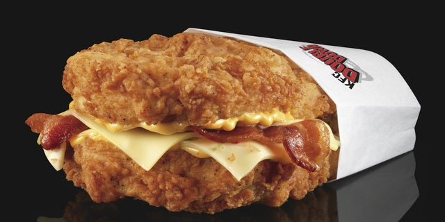 This undated product image provided by KFC shows their new Double Down sandwich. The Double Down is essentially a sandwich with two chicken filets taking the place of bread slices. In between are two pieces of bacon, melted slices of Monterey Jack and Pepper Jack cheese and a zesty sauce.     (AP Photo/KFC, Dan Kremer)
