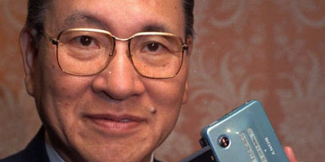 In this May 1991 file photo, former president and chairman of Sony, Norio Ohga, holds a Sony Mini Disc in New York. Sony says Ohga, credited with developing the compact disc, has died Saturday, April 23, 2011. He was 81. Sony Corp. Chairman Howard Stringer said Ohga helped redefine the Japanese manufacturer not only as an electronic hardware company but helped it also expand into software or entertainment. (AP/File)