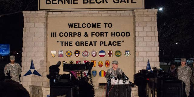 Lt. Gen. Mark Milley, commanding general of III Corps and Fort Hood, speaks with the press outside of an entrance to the Fort Hood military base following a shooting that occurred inside on April 2, 2014 in Fort Hood, TX. A soldier assigned to the military installation was found dead near a barracks over the weekend.. (AP Photo/ Tamir Kalifa)