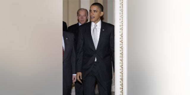 President Obama and Vice President Biden walk into the Senate Democratic caucus meeting on Capitol Hill(AP Photo)