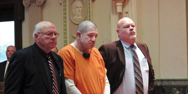 FILE - In this Jan. 14, 2015 file photo, Donald Hoffman, 41, stands between defense attorneys Robert Whitney, left, and Rolf Whitney as he pleads guilty to aggravated murder in a deal with prosecutors in Bucyrus, Ohio. Video of Hoffman's police interviews was released Friday, Feb. 13, 2015, and offers some explanation for the slayings, mostly a combination of drugs, money and anger. (AP Photo/Kantele Franko, File)