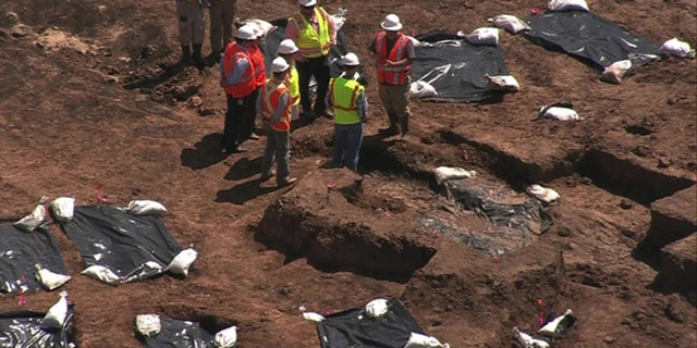 Forty-eight bodies have been exhumed thus far.