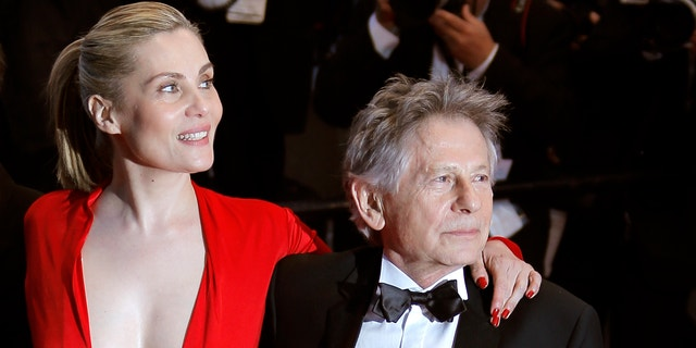 From left, actors Mathieu Amalric, Emmanuelle Seigner and director Roman Polanski leave following the screening of Venus In Fur at the 66th international film festival, in Cannes, southern France, Saturday, May 25, 2013. (AP Photo/Lionel Cironneau)