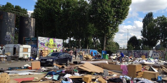This is an  image taken Thursday, Aug. 9, 2012  of the abandoned lot that Gypsies  had made their home for five months in Gennevilliers, outside Paris, shortly after they learned the encampment would be demolished. The Gypsy camps lack electricity and running water. Grocery carts become makeshift grills. Rats run rampant and fleas gnaw on young and old alike. It's a life that modernity has bypassed, compounded by a dismal economy that has stretched from their homeland in Romania to a France that wants them to go somewhere  anywhere  else. (AP Photo/ Lori Hinnant )