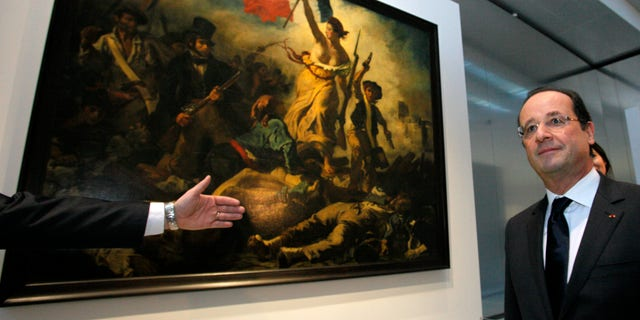 "Dec. 4, 2012 - FILE photo shows French Pres. Francois Hollande in front of  ""Liberty Leading the People,"" a painting by Eugene Delacroix at the Louvre Museum in Lens, northern France."