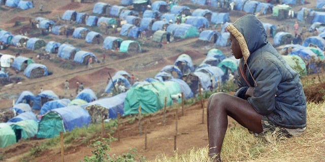 In this Aug. 25, 1994 file photo a young Tutsi refugee gazes upon the Tutsi camp of Nyarushishi, Rwanda, 6 miles southeast of Cyangugu. Two decades after the Rwandan genocide, France is finally opening what critics called its blind eye to justice over the killings. (AP)