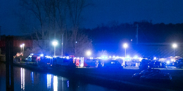 Rescue vehicles park between a canal and the railway tracks after a high-speed train derailed in Eckwersheim, near Strasbourg.