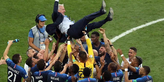 The French National Team celebrates after the FIFA World Cup against Croatia.