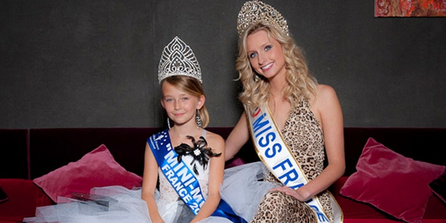 This undated photo provided by the Mini Miss committee shows Oceane Scharre, 10, elected Mini Miss France 2011, left, and Miss France 2011 Mathilde Florin. France's Senate voted Tuesday night, Sept. 17, 2013, to ban beauty pageants for children under 16, in an effort to protect children especially girls from being sexualized too early.