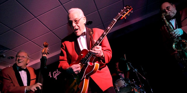 This March 21, 2005 file photo shows members of The Comets, from left to right, Marshall Lytle, Franny Beecher, and Joey Ambrose perform at Rock is Fifty party held at the Gibson Guitar Studio in New York. Beecher, lead guitarist for Bill Haley and the Comets, died Monday, Feb. 25, 2014.