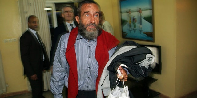 Oct. 30, 2013: Daniel Larribe, one of four Frenchmen held hostage by Al Qaeda militants for three years in the African Sahel, walks at the airport in Niamey, Niger.