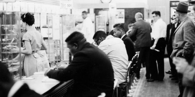 """February 1960: People take part in a civil rights """"sit-in"""" protest at the lunch counter in McCrory's in Rock Hill, S.C."""