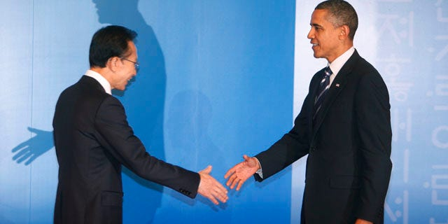 Nov. 11: South Korean President Lee Myung-bak, left, welcomes US President Barack Obama for a reception at the G-20 summit in Seoul, South Korea.