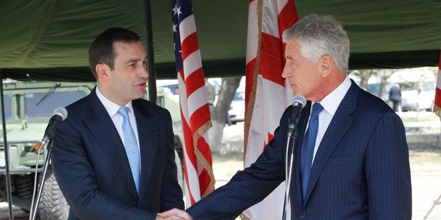Sept. 7, 2014: Georgia's Defense Minister  Irakli Alasania, left, and U.S. Defense Secretary Chuck Hagel shake hands at the Krtsanisi military training base outside Tbilisi  Georgia.