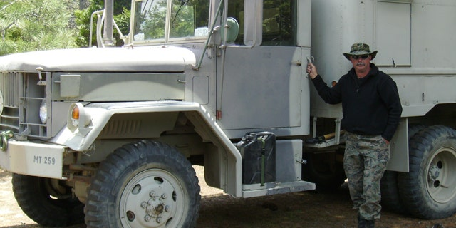 Jim Long and the 1967 A3 shop truck he bought from the government five years ago.