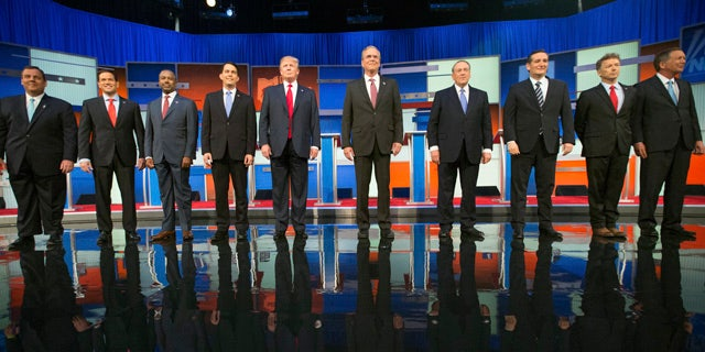 Aug. 6, 2015: Republican presidential candidates from left, Chris Christie, Marco Rubio, Ben Carson, Scott Walker, Donald Trump, Jeb Bush, Mike Huckabee, Ted Cruz, Rand Paul, and John Kasich take the stage for the first Republican presidential debate at the Quicken Loans Arena in Cleveland. (AP Photo/Andrew Harnik)