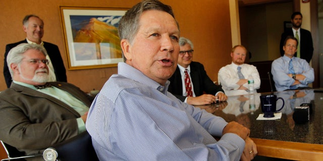 June 5, 2015: Ohio Gov. John Kasich speaks during a luncheon meeting with area business leaders in Concord, N.H. (AP Photo/Jim Cole)