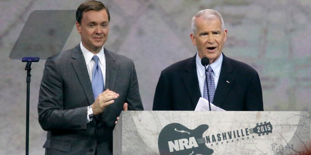 April 10, 2015: Retired Marine Lt. Col. Oliver North, right, speaks at the National Rifle Association convention in Nashville, Tenn.