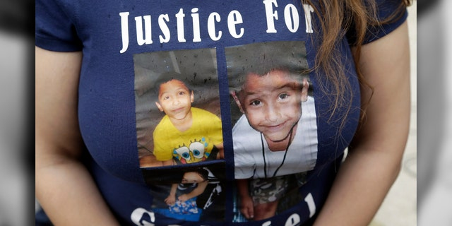 In this April 7, 2016, file photo, a friend of the family of Gabriel Fernandez wears a shirt with his likeness.