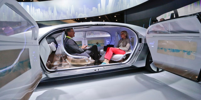 FILE - In this January 2015 file photo, attendees sit in the self-driving Mercedes-Benz F 015 concept car at the Mercedes-Benz booth at the International CES, in Las Vegas. Everything we buy or use these days has the potential to be smarter. Self-driving cars can transform our commuting hours into productive time. Sensor-laden socks can let us know how to jog with fewer injuries. The 2016 International CES will have a panoply of vendors showing off such connected devices, from smart umbrellas that will notify you if youve left them behind, to navigation devices that project directions on car windshields so you dont have to take your eyes off the road. (AP Photo/Jae C. Hong, File)