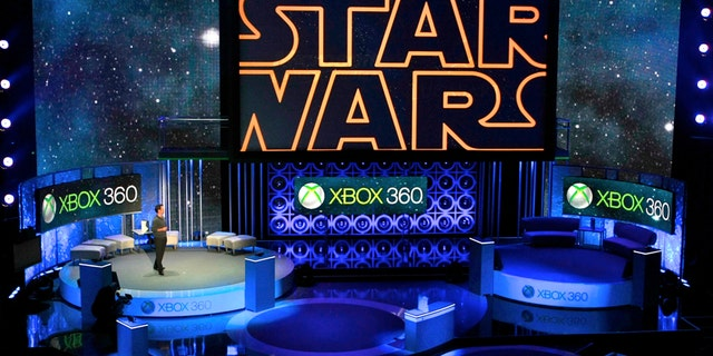 """In this June 14, 2010 file photo, Microsoft presents an upcoming LucasArts' """"Star Wars"""" video game for its new Xbox 360 with Kinect technology, during the 2010 Xbox 360 media briefing at the Wiltern Theater, in Los Angeles."""