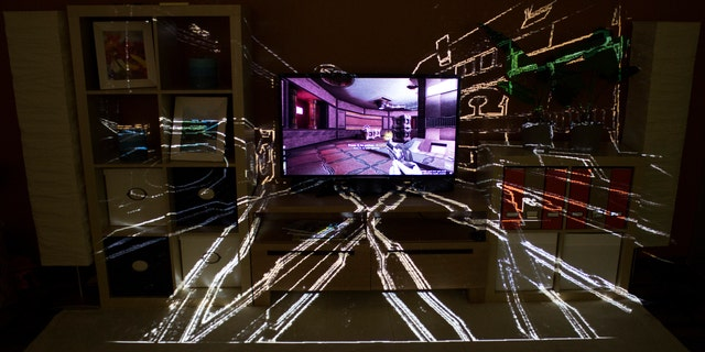 The IllumiRoom project, a proof-of-concept system combining a projector and sensor to project visualizations and augment areas surrounding a TV screen.