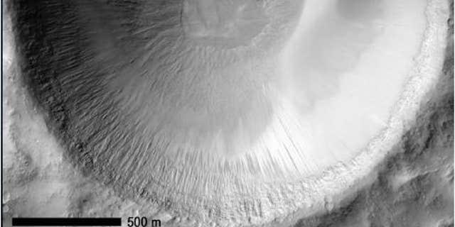 Recurring slope lineae (RSL) seep in Garni crater on the floor of Mars' Melas Chasm.