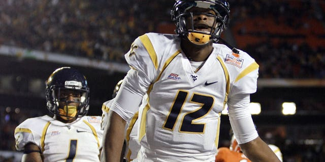 January 4, 2012: West Virginia quarterback Geno Smith celebrates a touchdown during the first half of the Orange Bowl NCAA college football game against Clemson in Miami.