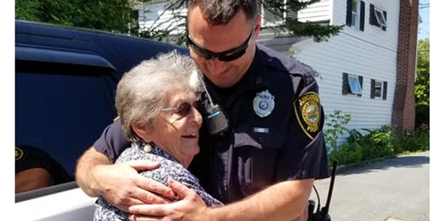 """Simone """"wondered what it was like to be arrested and sit in the back seat."""" She now refers to the patrol car's owner, Officer Paul Doody (right) as """"her cop."""" (Anne Dumont)"""