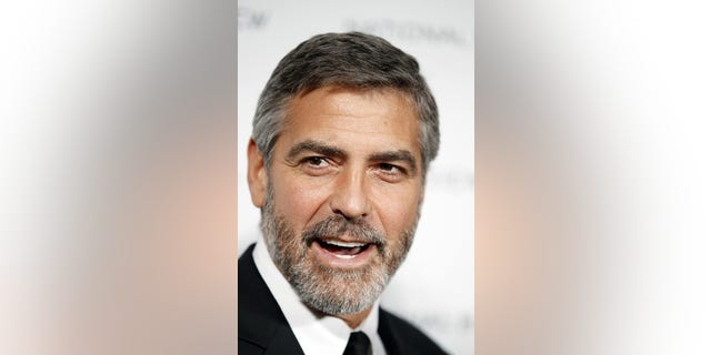 """Actor George Clooney arrives to accept the award for Best Actor for his role in """"Up In The Air"""" at the National Board of Review Award ceremony in New York in this January 12, 2010 file photo. Clooney was nominated for best actor for his role in the film """"Up in the Air"""" for the 82nd Academy Awards, announced February 2, 2010. The Oscars will be presented in Hollywood March 7, 2010. REUTERS/Lucas Jackson/Files  (UNITED STATES - Tags: ENTERTAINMENT HEADSHOT)"""