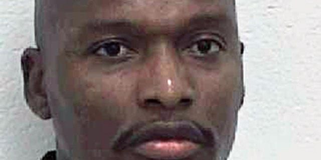 FILE - This undated file photo provided by the Georgia Department of Corrections shows convicted murderer Warren Lee Hill. (AP Photo/Georgia Dept. of Corrections, File)