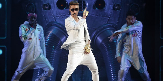 """March 28, 2013: In this file photo, Canadian singer Justin Bieber performs on stage during the """"I Believe Tour """" in Munich, southern Germany."""