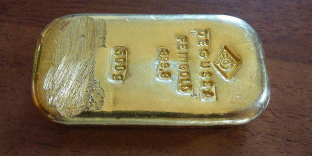 The photo released by the police in Rosenheim on Aug. 12, 2015 shows a gold bar that was found by a teenager when swimming in a lake near Berchtesgaden. Police said in a statement that they still try to find out from where the 500g (17.6-ounce) bar came.  (Polizeipraesidium Oberbayern Sued via AP)