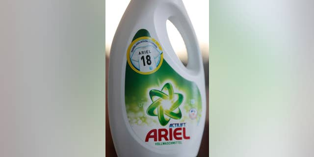 An Ariel liquid detergent bottle with an '18' on it sits in Berlin Germany, Friday, May 9, 2014. Detergent manufacturer Procter & Gamble has kicked up a froth in Germany after unintentionally placing a neo-Nazi code on promotional packages for Ariel washing powder. The use of Nazi slogans in public is banned in Germany, which neo-Nazis often try to circumvent by using codes. '18' stands for Adolf Hitler. (AP Photo/Ferdinand Ostrop)