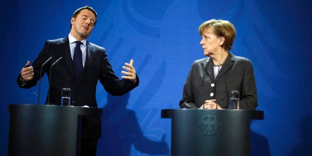 German Chancellor Angela Merkel, right and Italian Prime Minister Matteo Renzi brief the media, after German and Italian government consultations at the chancellery in Berlin, Monday, March 17, 2014. (AP Photo/Markus Schreiber)