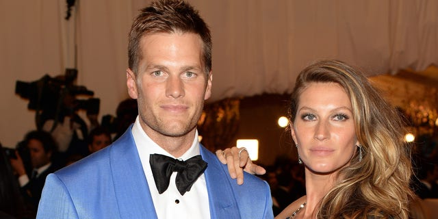 "NEW YORK, NY - MAY 06:  Tom Brady and Gisele Bundchen attend the Costume Institute Gala for the ""PUNK: Chaos to Couture"" exhibition at the Metropolitan Museum of Art on May 6, 2013 in New York City.  (Photo by Dimitrios Kambouris/Getty Images)"