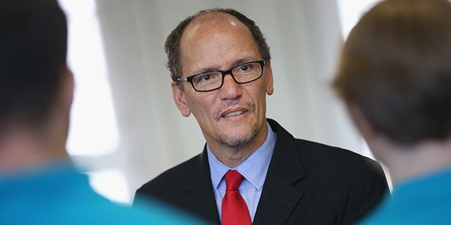 BERLIN, GERMANY - OCTOBER 28:  U.S. Labor Secretary Thomas Perez chats with trainees at the Siemens training facility on October 28, 2014 in Berlin, Germany. Secretary Perez visited the center to learn more about the German trainee system, in which manufacturers offer paid multi-year training programs to recent high school graduates. U.S. President Obama has expressed interest in adopting the system in the U.S., where thus far training is usually conducted at technical or community colleges, as a way enhance job growth, meet the job requirements of U.S. industry and make the U.S. economy more competitive.  (Photo by Sean Gallup/Getty Images)