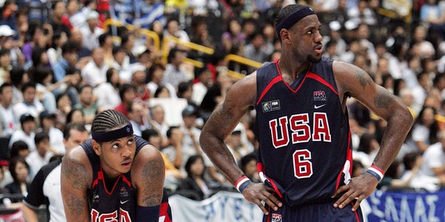 SAITAMA, JAPAN - SEPTEMBER 1: Carmelo Anthony #15 and LeBron James #6 of US wait for the free throw of Greece before the game ended during the FIBA World Championship 2006 Semi-Finals on September 1, 2006 in Saitama, Japan. The Championship takes place from August 19 to September 3 in Japan. (Photo by Junko Kimura/Getty Images)