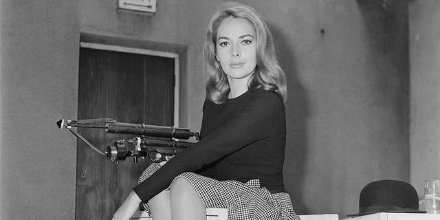 German actress Karin Dor holding a harpoon gun, 6th October 1966. She is starring in the James Bond film 'You Only Live Twice'.  (Photo by Larry Ellis/Express/Hulton Archive/Getty Images)