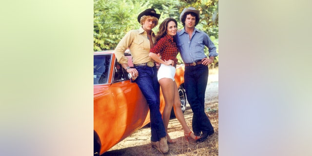 John Schneider, Catherine Bach and Tom Wopat in a promotional portrait for the TV show 'The Dukes of Hazzard', circa 1980. They played Bo, Daisy and Luke Duke, respectively.