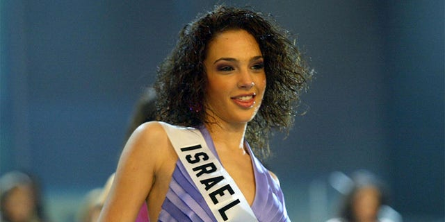 QUITO, ECUADOR:  Miss Israel Gal Gadot smiles during the Miss Universe final show in Quito, Ecuador, 01 June 2004.   AFP PHOTO/MARTIN BERNETTI  (Photo credit should read MARTIN BERNETTI/AFP/Getty Images)