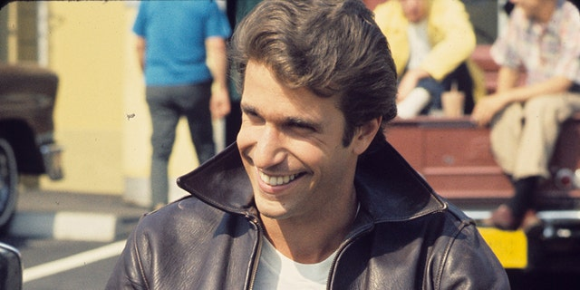 """Happy Days"" star Fonzie (Henry Winkler) sits on his motorcycle."