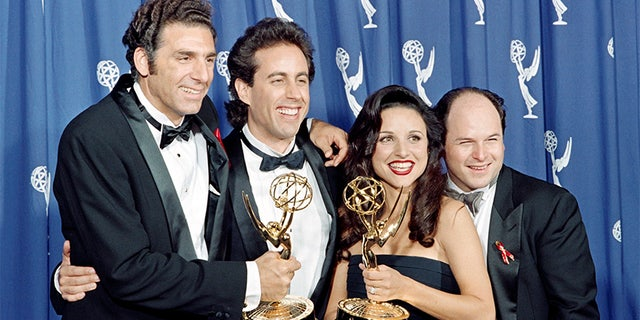 """The cast of the Emmy-winning """"Seinfeld"""" show pose with the Emmys they won for Outstanding Comedy Series on September 19, 1993 in Pasadena, CA. From left to right:  Michael Richards, Jerry Seinfeld, Julia Louis-Dreyfus and Jason Alexander. (Photo credit should read SCOTT FLYNN/AFP/Getty Images)"""
