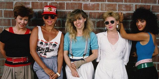 The Go-Go's, (L-R) Gina Schock (drums), Belinda Carlisle (lead vocals), Charlotte Caffey (lead guitar), Kathy Valentine (bass), and Jane Wiedlin (rhythm guitar), playfully pose during a 1985 Hollywood, California, portrait session.
